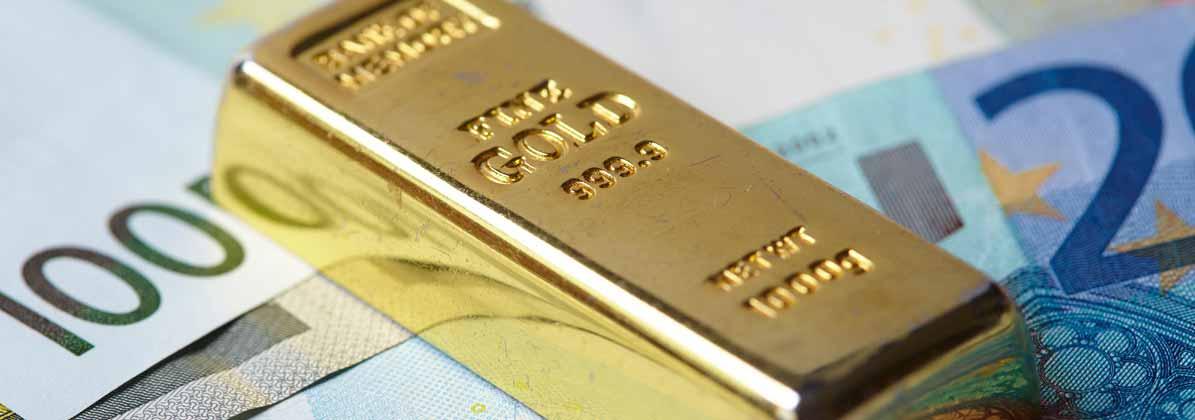 1 Goldbarren und Geldscheine