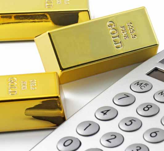 Goldbarren und ein Taschenrechner
