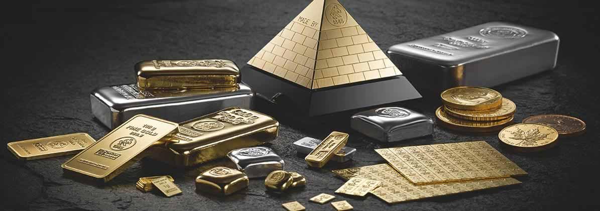 Verschiedene Goldbarren und Goldmünzen